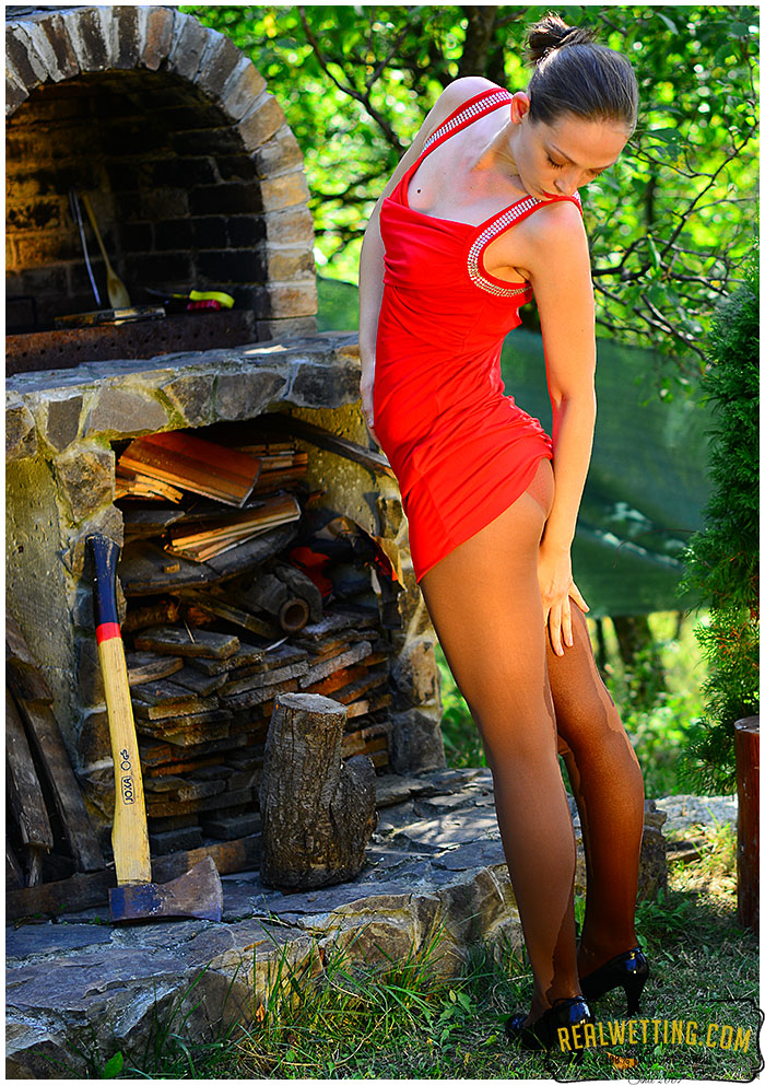 Claudia gushes into her red dress and pantyhose