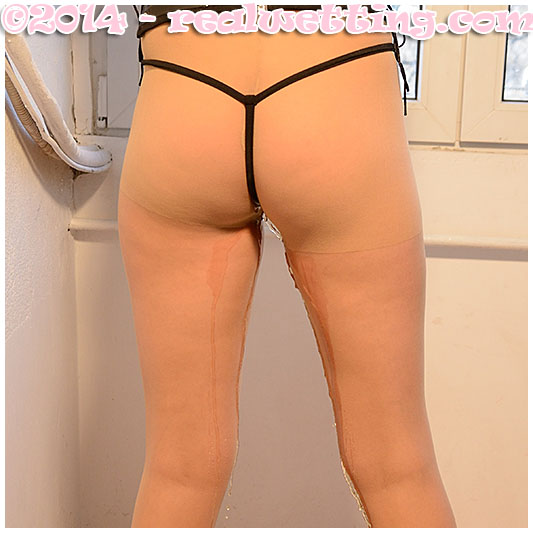 Mistress Debbie urinates herself waiting desperate to pee for a customer pissing her pantyhose and PVC panties