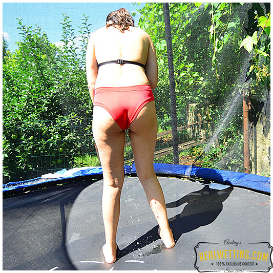 Lady jumps on trampoline until she pisses herself