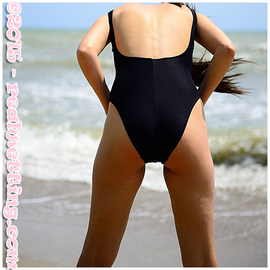 PIssing her swim suit at the beach desperate accident female wetting herself