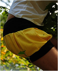 dee climbing down a tree pees her yellow shorts5