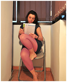 dee is pissing her pink lycra tights while reading for a exam 00