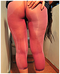 dee is pissing her pink lycra tights while reading for a exam 02