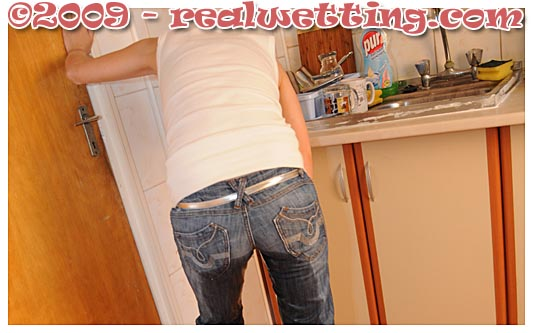 dee urinates herself wetting jeans