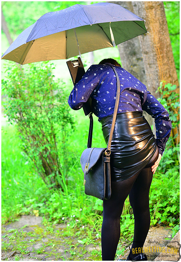 Watch this girl wetting herself in the rain