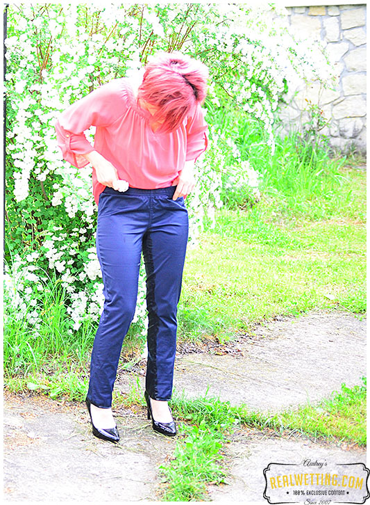 Dee wets satin pants caring for her garden
