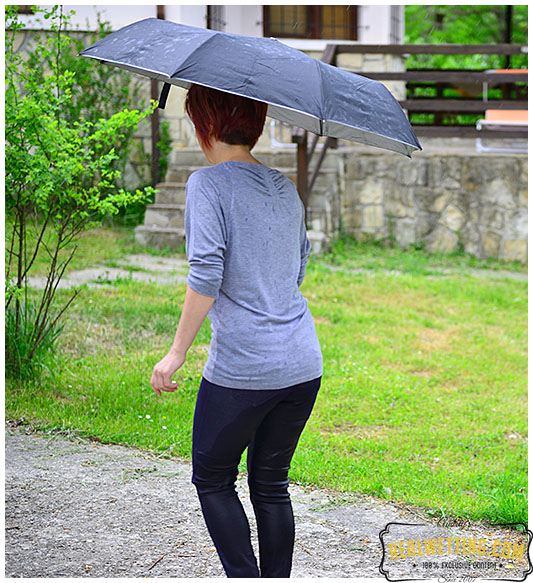 Running from the rain makes lady tight jeans soaking wet with pee