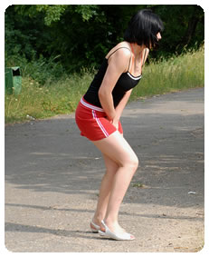desperate teenager pisses her knickers in public wetting her skirt