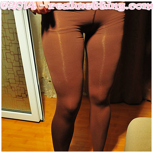 Dominika wets herself on the table peeing her pantyhose and pink knickers