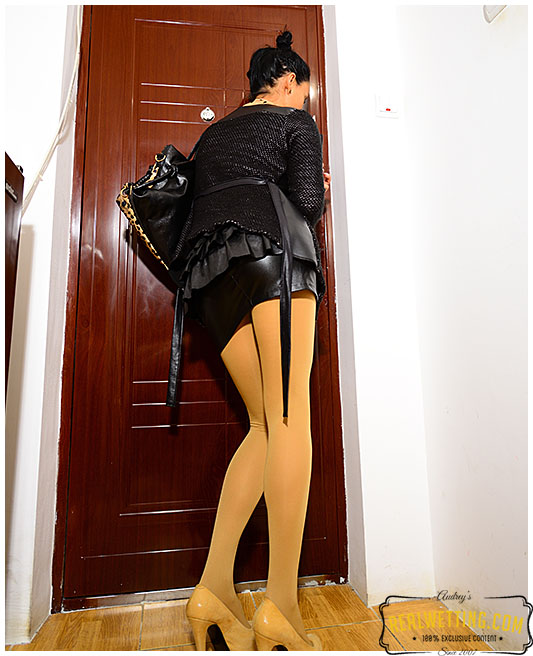 Secretary makes pantyhose damp with trails of piss running down her legs