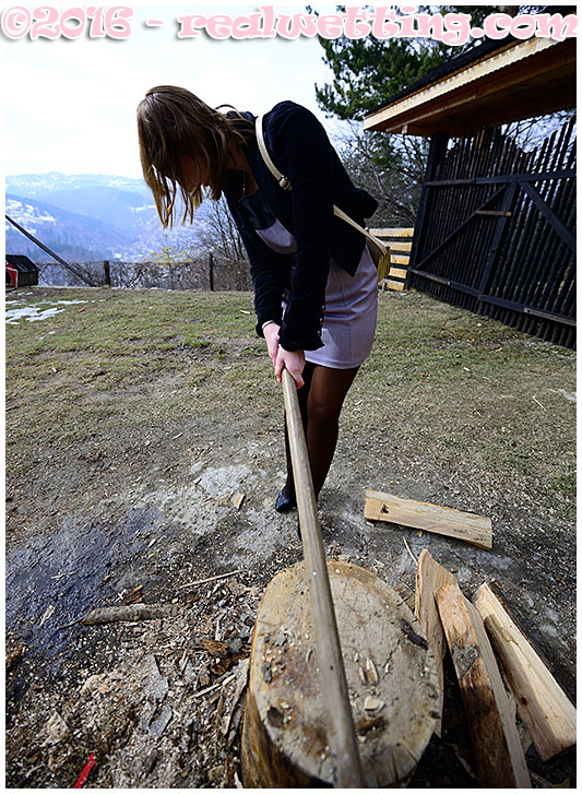 Splitting wood for the fireplace Gemma leaks piss all over herself