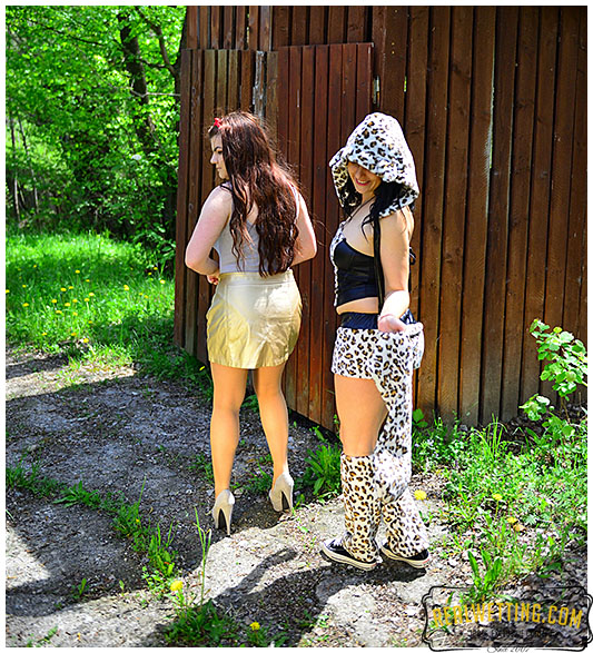 Two girls wet their panties at the costume fair waiting in line for the toilet
