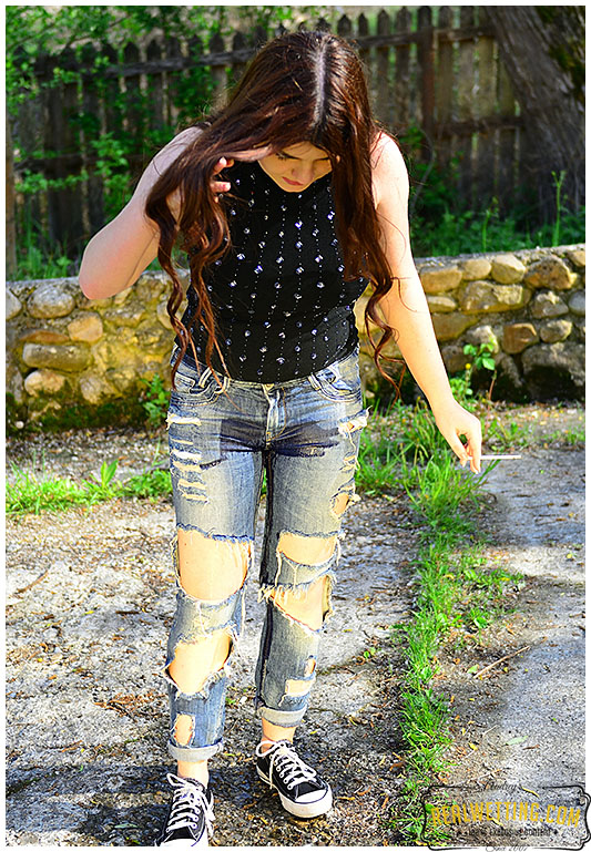 Torn jeans wetting bored with smoking