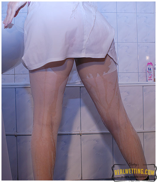 Laura takes a piss in her clothes then washes during fully clothed shower