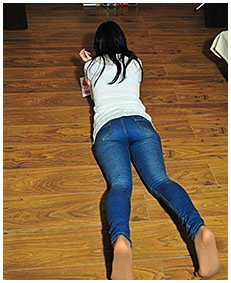 lying on her tummy antonia wets her jeans 04