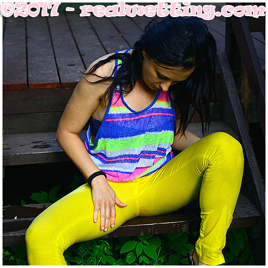 Monica pisses her yellow pants again in the same day. Rewetting experience from monica!