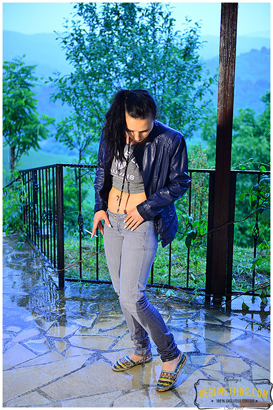 girl wets gray jeans during rain storm