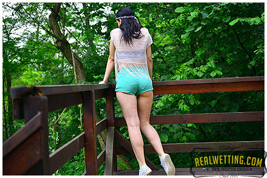 Horny hippie pisses herself wetting shorts