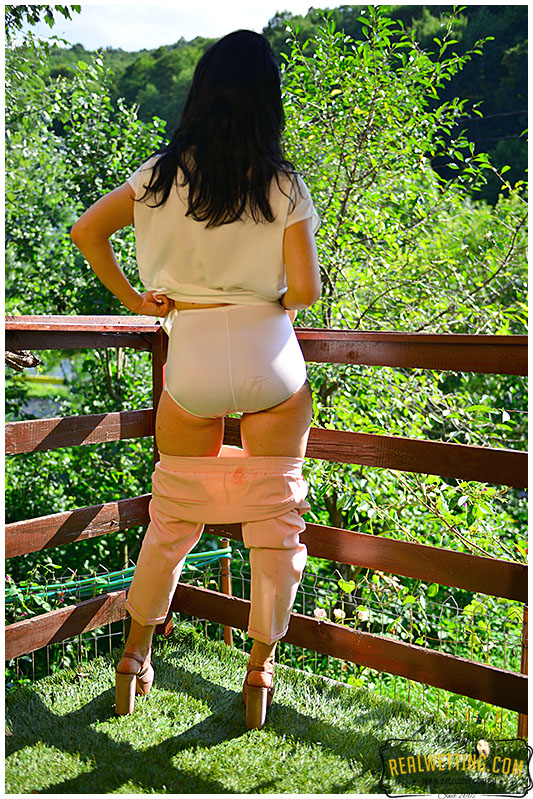 Wetting her stylish outfit business pants and panties