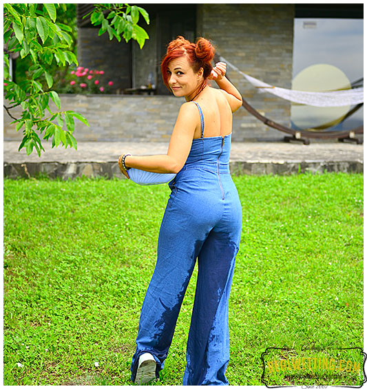 Shocking overalls wearing lady pees her pants desperate to pee