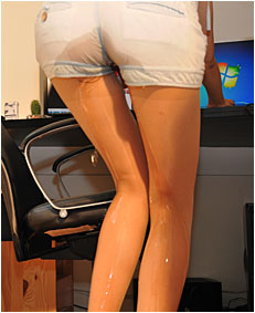 Natalie wets her overalls and pantyhose playing a fun computer game