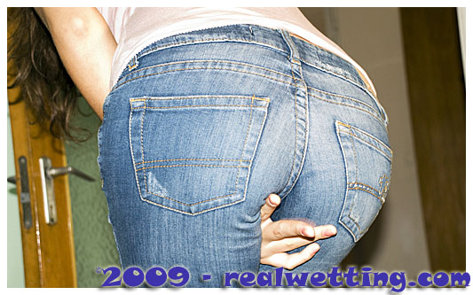 poor girl pisses herself in her jeans wetting her jeans