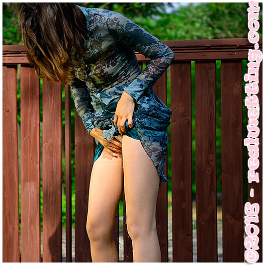 Pissing herself wetting her pantyhose!