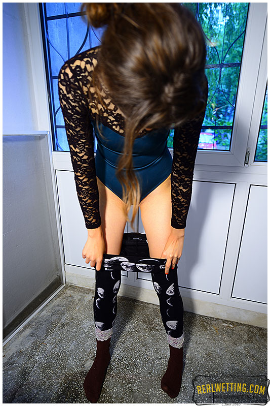 Natalie makes her tights soaking wet when measuring her balcony for renovation