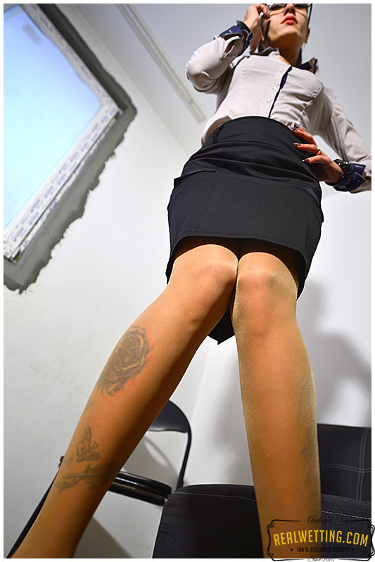 Olivia makes her pencil skirt damp