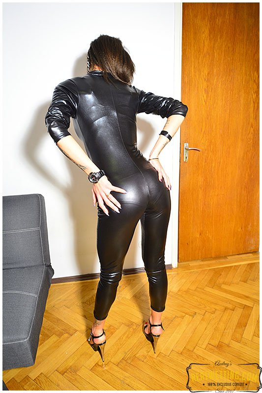 Olivia things shes getting away with pissing her plastic catsuit