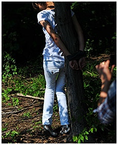 peeing in white jeans while she is tied to a tree 00