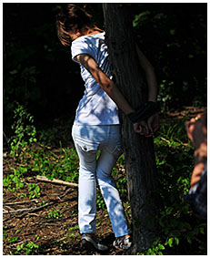 peeing in white jeans while she is tied to a tree 01