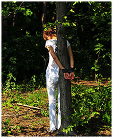 peeing in white jeans while she is tied to a tree 03