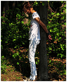 peeing in white jeans while she is tied to a tree 04