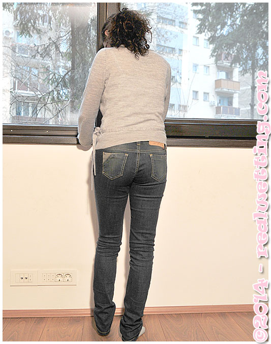 sexy girl sara wets her jeans by the window