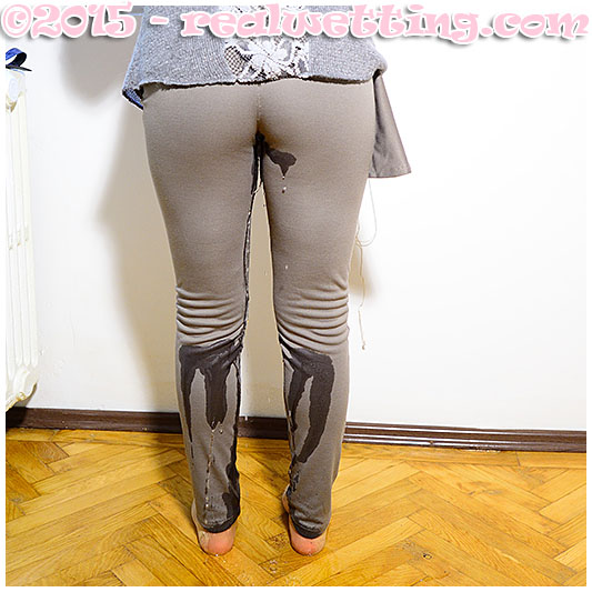 super sexy video girl wets her leggings desperate while eating losing control of her bladder