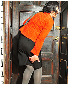 Valerie pisses herself in skirt and pantyhose
