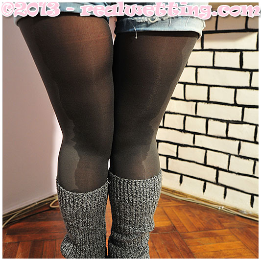 Valerie wets her jeans shorts and shiny gray pantyhose
