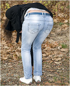 wetting jeans while picking up acorns 0011