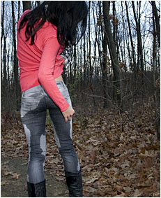 wetting jeans while walking in the park pissing her jeans 0048