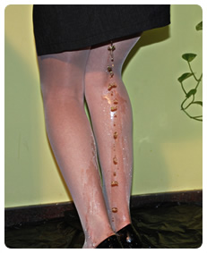 woman lost control and has a piss accident wetting her panty hose nylons pee piss urine accident